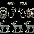 A group of nine bronze animal- form plaques, 5th to 3rd century bc