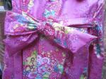 Ciré AGLAE en coton enduit Rose fushia imprimé fleuri, fermé par un noeud (3)
