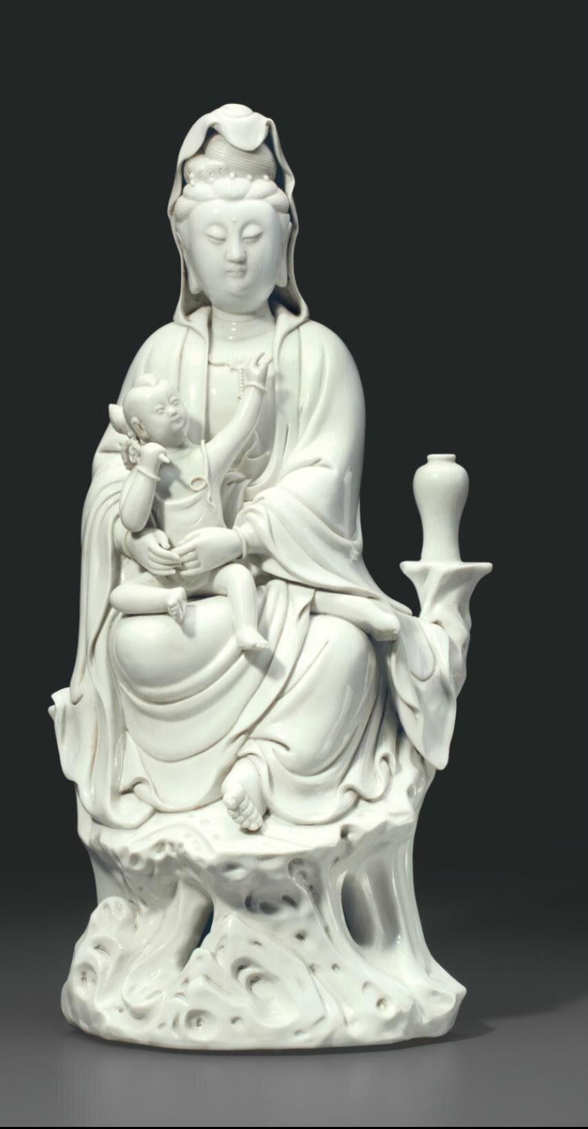 A large Dehua group of Guanyin and a child, Late Qing dynasty