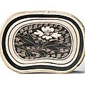 A Cizhou painted and sgraffito'Lotus' bean-shaped pillow, Northern Song dynasty (960-1127)