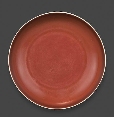 A copper red glazed dish, Qianlong six-character mark and of the period