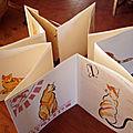Le chat de mimo dans un carnet
