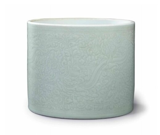 A celadon-glazed carved brush pot, China, Qing dynasty, Kangxi period (1662-1722)