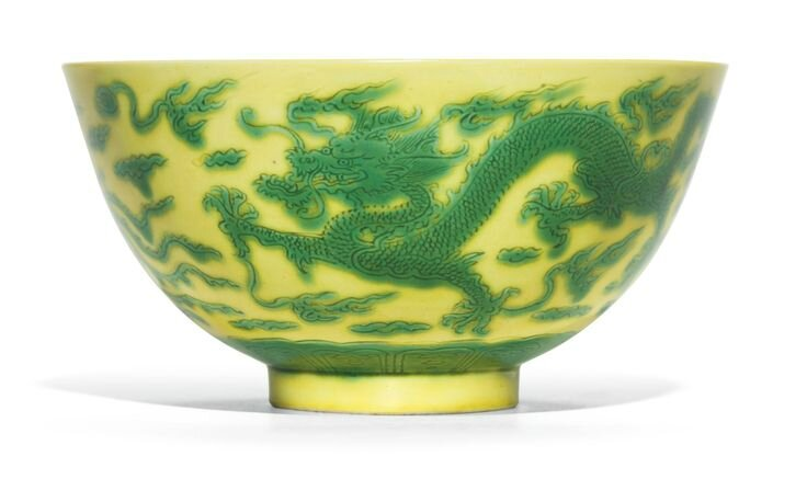 A yellow-ground green-enameled 'dragon and phoenix' bowl, Kangxi mark and period