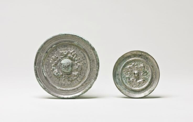 Two bronze 'Dragon' and 'Mythical Beast' mirrors, Han dynasty andTang dynasty
