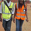 Avec mon amie Cynthia KYALIKA en visite des chantiers, pendant notre stage, 2012