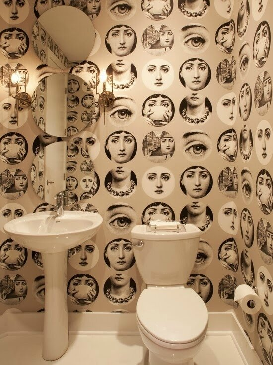 fornasetti plates gray wallpaper in powderroom bathroom