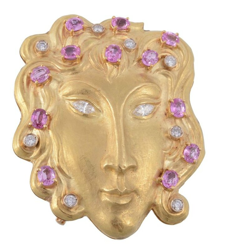 A pink sapphire and diamond mask brooch by Rinaldi