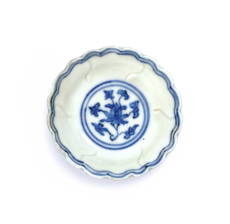 A miniature blue and white lobed 'floral' medicine dish, Mark and period of Jiajing