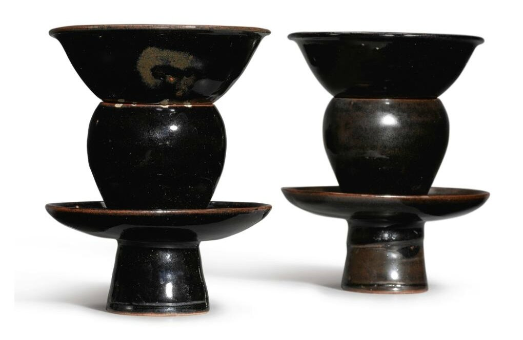 A pair of small black-glazed bowls and stands, Northern Song-Jin Dynasty