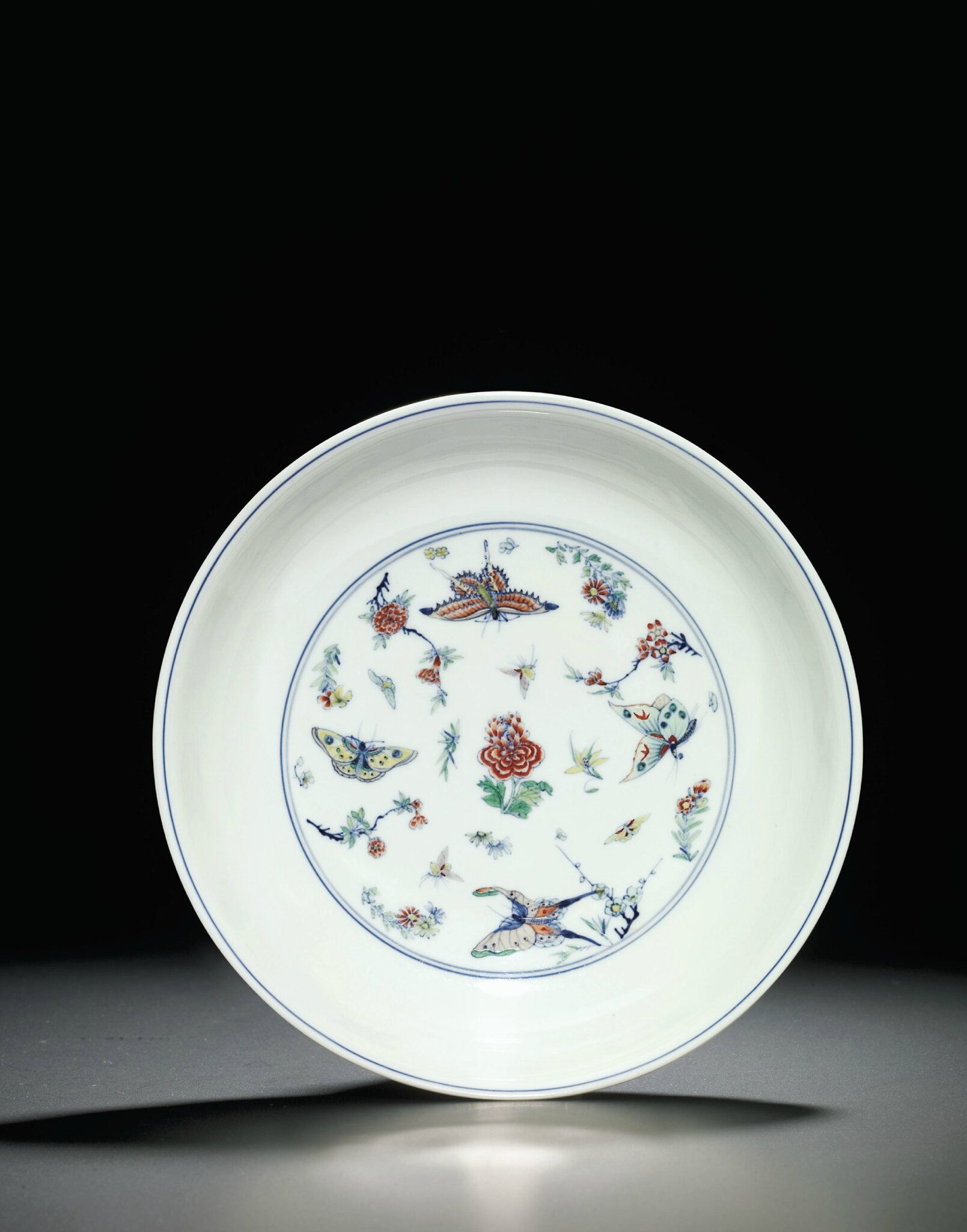 A Fine and Extremely Rare doucai 'Butterfly' Dish, Yongzheng six-character mark within double circles and of the period (1723-1735)