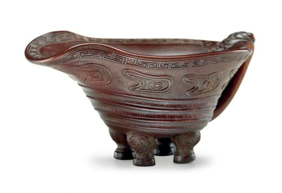 An unusual rhinoceros horn four-legged pouring vessel, 17th-18th century