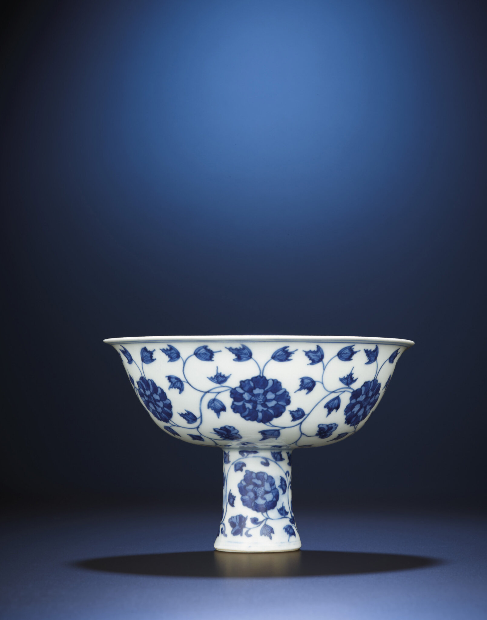 A very rare Ming blue and white stembowl, Wanli six-character mark in a line and of the period (1573-1619)