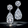 An elegant pair of diamond earrings, by harry winston