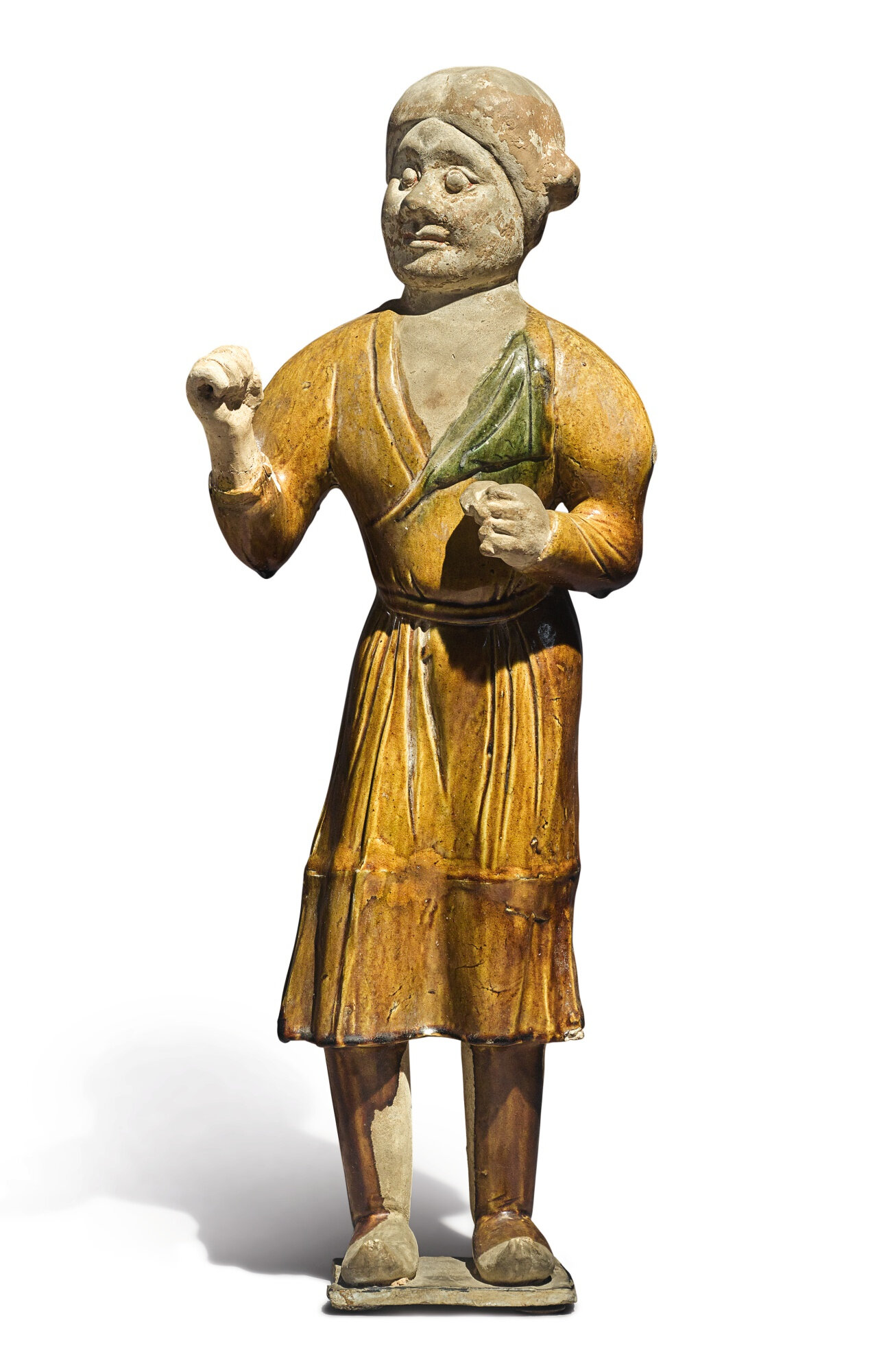 An amber and green-glazed pottery figure of a groom, Tang dynasty (618-907)
