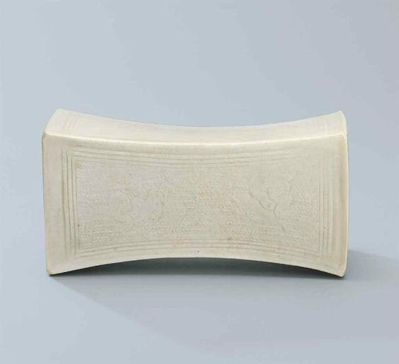 A carved Qingbai 'boys' rectangular pillow, Northern Song dynasty (960-1127)