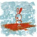 lapin sur tapis volant orange