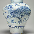 A blue and white porcelain jar with a tiger and mythical lion (haetae), joseon dynasty, 19th century