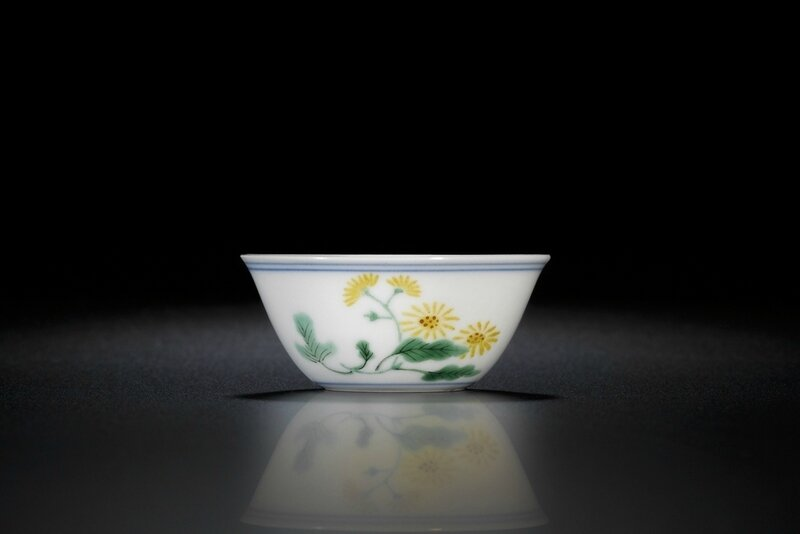 An exquisitely enamelled wucai 'butterflies and asters' winecup, Mark and period of Kangxi (1662-1722)