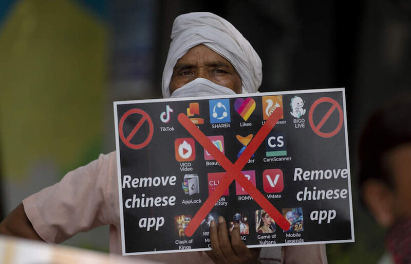 An-Indian-man-holds-a-placard-urging-ban-on-Chinese-apps-The-Economic-Times