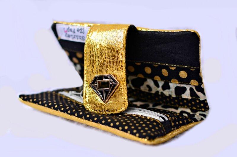 portefeuille en cuir or et noir