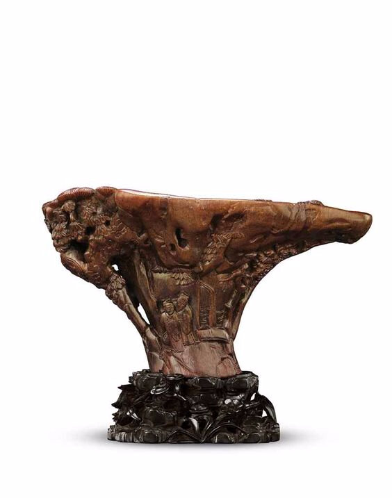 A finely carved 'Scholars' rhinoceros horn libation cup, Ming dynasty, early 17th century
