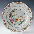 Famille rose plate depicting european hunter with dog. qianlong period, circa 1750