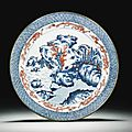 A copper-red and underglaze-blue 'landscape' dish, qing dynasty, kangxi period - sotheby's