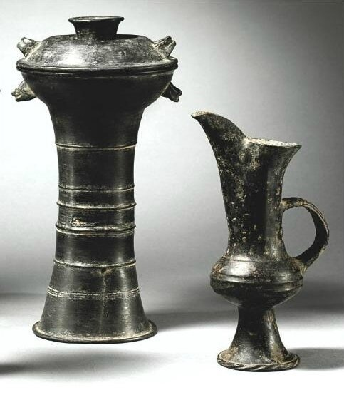 Two burnished black pottery vessels, Neolithic, Longshan Culture, (2500-2000 BC)