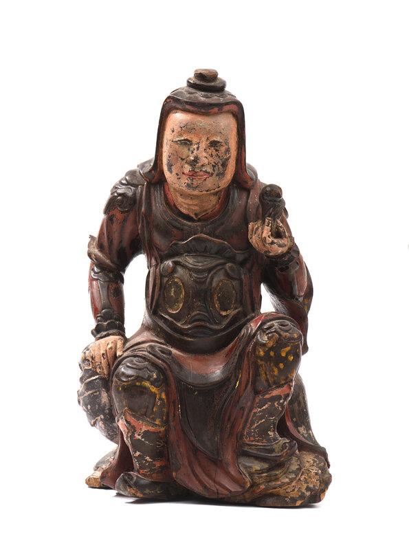 Sculpture en bois laqué représentant un guerrier ou gardien assis sur le dos d'un lion, Vietnam, XIXe siècle