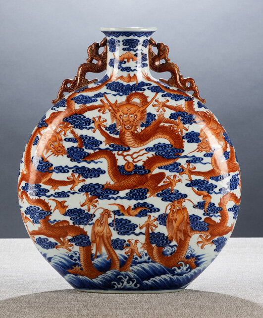 A fine and very rare iron-red and underglaze blue-decorated two-handled 'moon' flask, Bianhu, Qianlong sealmark in underglaze blue, and of the period (1736-1795)