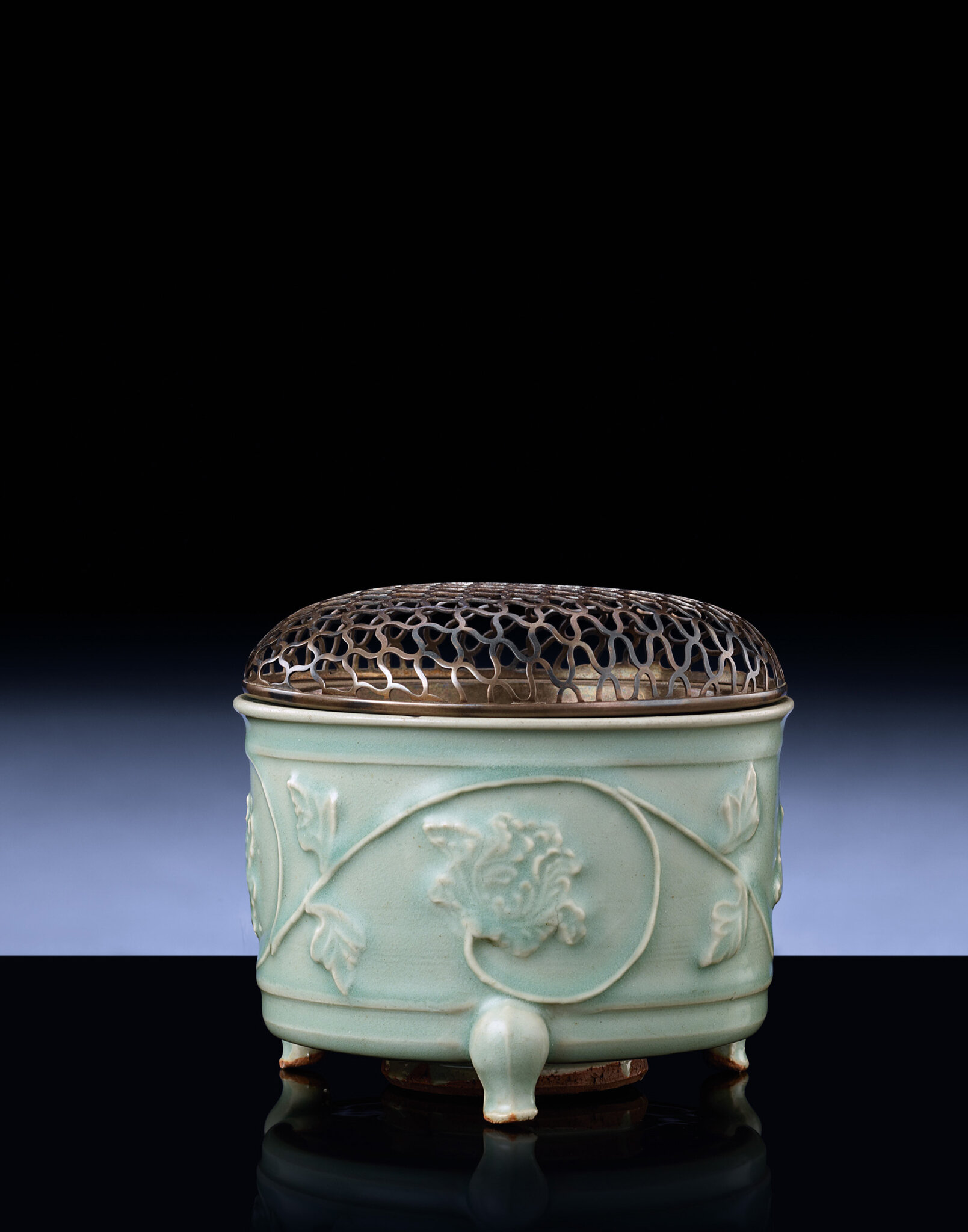 A Longquan celadon relief-decorated tripod censer, Southern Song-Yuan Dynasty, 13th-14th century