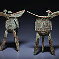 A pair of bronze ritual tripod wine vessels, jue, late shang dynasty, 13th-12th century bc