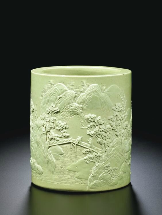 A carved lime-green glazed 'Landscape' brushpotby Wang Bingrong, Qing dynasty, Daoguang period (1821-1850)