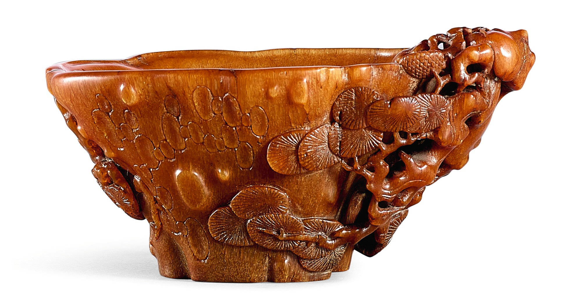 A small rhinoceros horn 'Pine' libation cup, 17th century