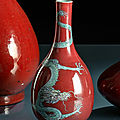 A copper-red glazed porcelain bottle vase with a green and blue enamel dragon, 19th century