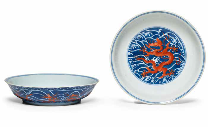 Two underglaze blue and iron-red 'dragon' dishes, Daoguang seal marks and of the period (1821-1850)