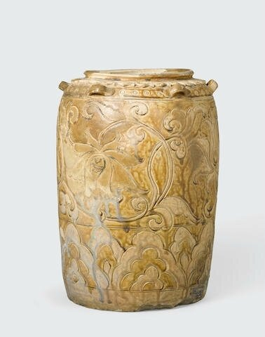 A cream glazed storage jar with brown inlay floral decoration