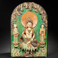 A rare and large sancai-glazed architectural fitting of guanyin in a grotto, ming dynasty