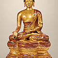 A highly important and monumental imperial gilt-lacquered wood figure of the medicine buddha, qing dynasty, 18th century