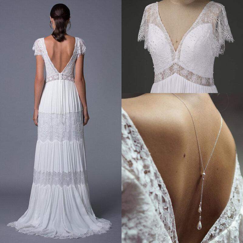 robe de mariée longue bohème dentelle col v dos nu avec mancherons