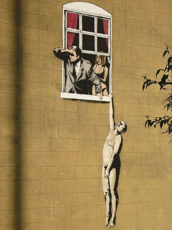 768px-Banksy_lovers