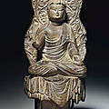 A dark grey limestone figure of amitabha buddha, inscribed jinglong third year (709), and of the period