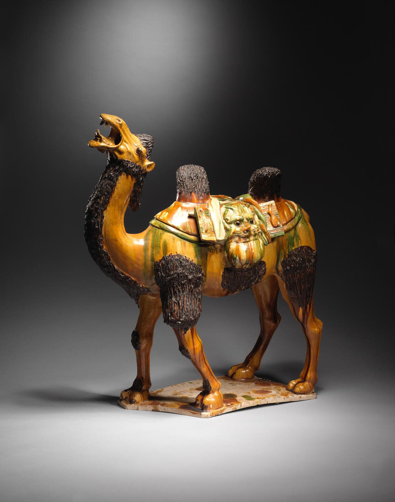 A magnificent and large sancai-glazed figure of a Bactrian camel, Tang Dynasty (618-907)