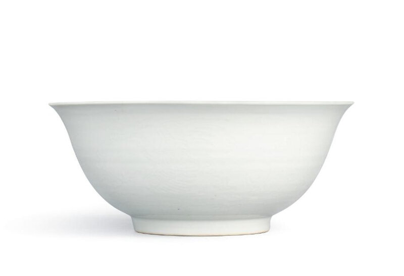 A white-glazed anhua-decorated 'phoenix' bowl, Mark and period of Jiajing (1522-1566)