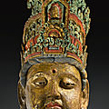 A massive polychromed carved wood head of a boddhisattva, song-jin dynasty (960-1234)