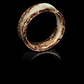 A yellow and russet jade bangle, shang dynasty or later