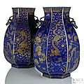 A fine pair of gilt-painted powderblue-ground octagonal porcelain vases, Guangxu marks and period with double dragon