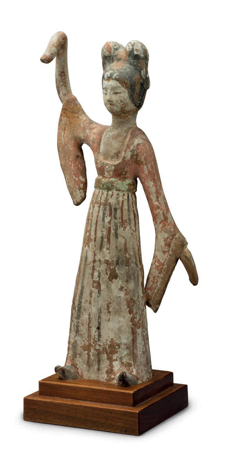 A painted pottery figure of a dancing lady, China, Tang dynasty (AD 618-907)