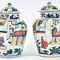 A pair of chinese wucai porcelain jars and covers, transitional period